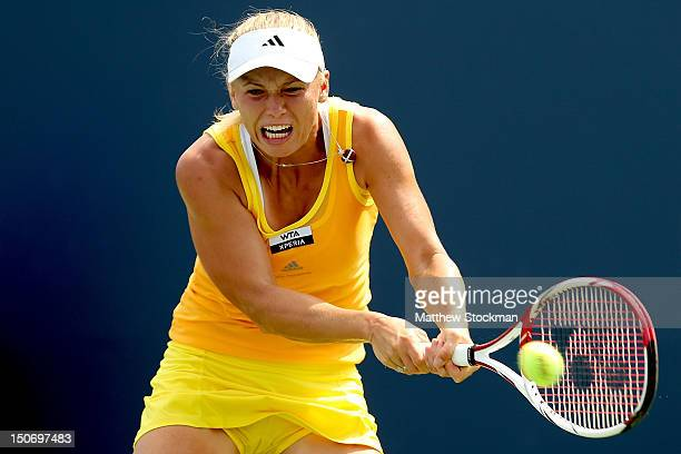 Caroline Wozniacki of Denmark returns a shot to Maria Kirilenko of Russia during the semifinals of the New Haven Open at Yale at the Connecticut...