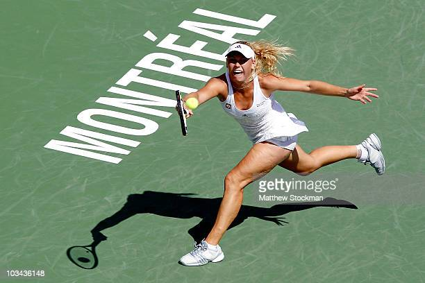 Caroline Wozniacki of denmark returns a shot to Patty Schnyder of Switzerland during the Rogers Cup at Stade Uniprix on August 18 2010 in Montreal...