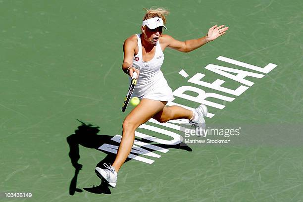 Caroline Wozniacki of denmark returns a shot to Patty Schnyder of Switzerland during the Rogers Cup at Stade Uniprix on August 18, 2010 in Montreal,...
