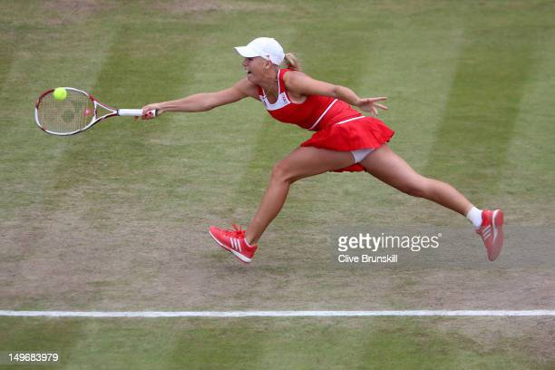 Caroline Wozniacki of Denmark returns a shot to Serena Williams of the United States during the Quarterfinals of Women's Singles Tennis on Day 6 of...