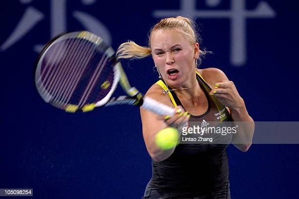 Caroline Wozniacki of Denmark returns a shot to Shahar Peer of Israel during day nine of the 2010 China Open at the National Tennis Center on October...
