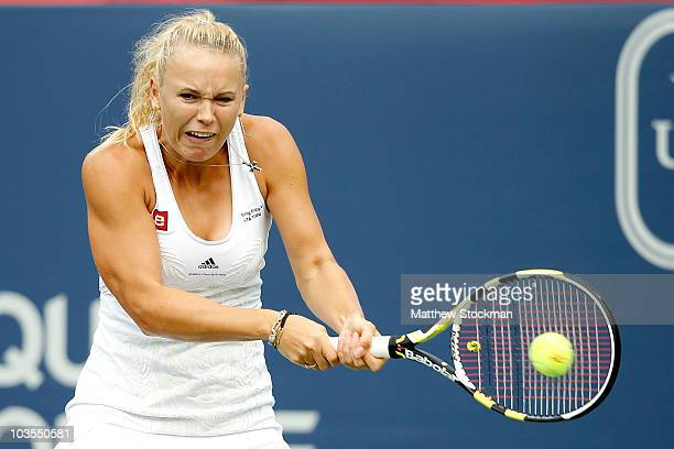 Caroline Wozniacki of Denmark returns a shot to Svetlana Kuznetsova of Russia during the semifinals of the Rogers Cup at Stade Uniprix on August 23,...