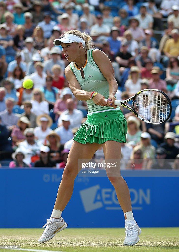 Caroline Wozniacki of Denmark returns against Camila Giorgi of Italy during their singles match on day six of the Aegon International at Devonshire Park on June 19, 2014 in Eastbourne, England.