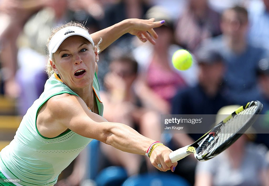 Caroline Wozniacki of Denmark returns against Camila Giorgi of Italy during their singles match on day six of the Aegon International at Devonshire Park on June 19, 2014 in Eastbourne, England.