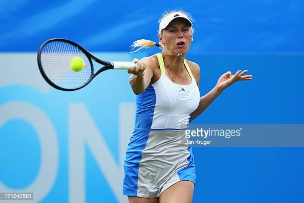 Caroline Wozniacki of Denmark returns in her women's singles semi final match against Jamie Hampton of USA during day seven of the AEGON...