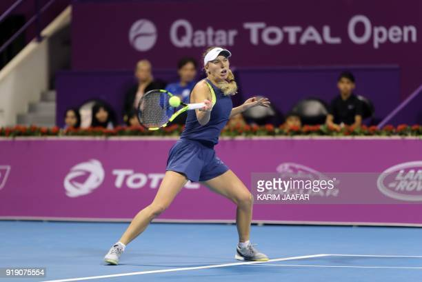 Caroline Wozniacki of Denmark returns the ball to Angelique Kerber of Germany during their singles match in the quarterfinal round of the Qatar Open...
