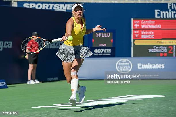 Caroline Wozniacki of Denmark returns the ball to Belinda Bencic of Switzerland during their match on day 3 of the Rogers Cup at the Aviva Centre in...