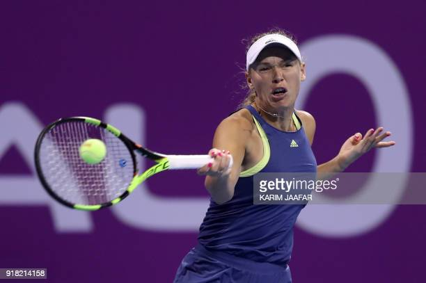 Caroline Wozniacki of Denmark returns the ball to Carina Witthöft of Germany during their singles second match at the 2018 WTA Qatar Open in the...