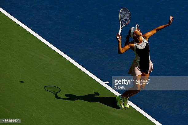 Caroline Wozniacki of Denmark serves against Jamie Loeb of the United States during their Women's Singles First Round match on Day Two of the 2015 US...