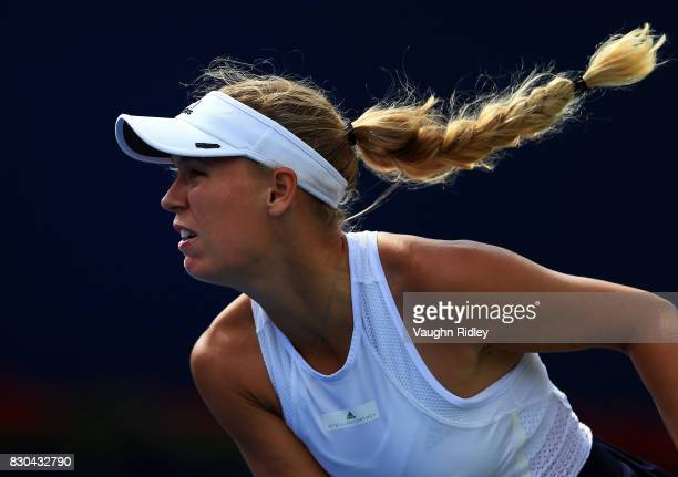 Caroline Wozniacki of Denmark serves against Karolina Pliskova of Czech Republic during Day 7 of the Rogers Cup at Aviva Centre on August 11 2017 in...