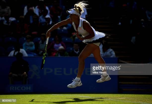 Caroline Wozniacki of Denmark serves during the ladies singles quarter final match against Simona Halep of Romania on day five of the Aegon...
