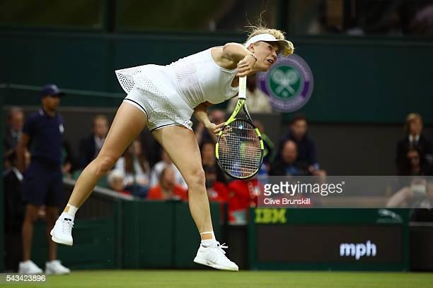 Caroline Wozniacki of Denmark serves during the Ladies Singles first round match against Svetlana Kuznetsova of Russia on day two of the Wimbledon...