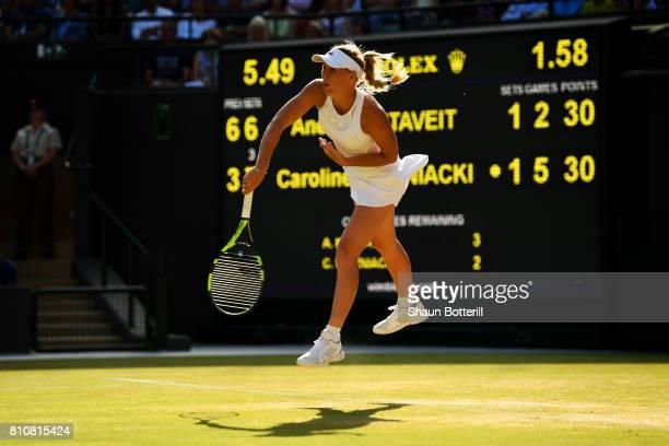 Caroline Wozniacki of Denmark serves during the Ladies Singles third round match against Anett Kontaveit of Estonia on day six of the Wimbledon Lawn...