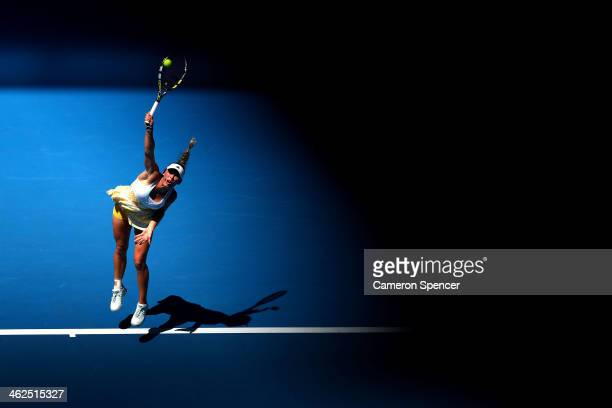 Caroline Wozniacki of Denmark serves in her first round match against Lourdes Dominguez Lino of Spain during day two of the 2014 Australian Open at...