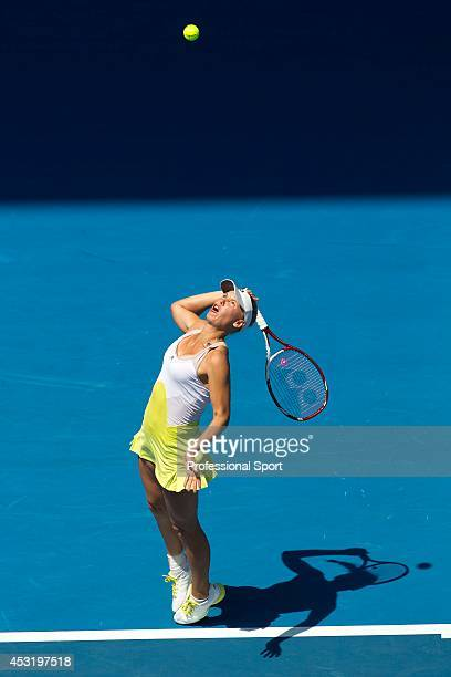 Caroline Wozniacki of Denmark serves in her fourth round match against Svetlana Kuznetsova of Russia during day eight of the 2013 Australian Open at...