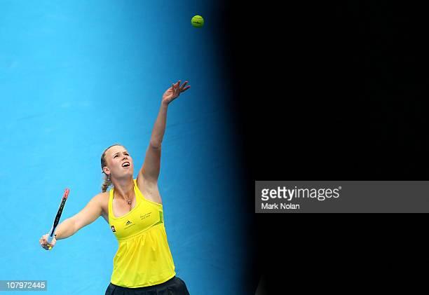 Caroline Wozniacki of Denmark serves in her match against Dominika Cibulkova of Slovakia during day three of the 2011 Medibank International at...
