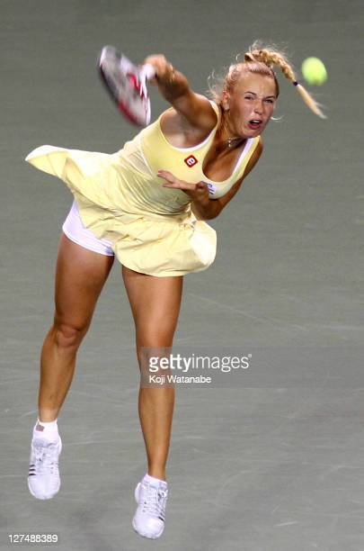 Caroline Wozniacki of Denmark serves in her match against Kaia Kanepi of Estonia during day four of the Toray Pan Pacific Open at Ariake Colosseum on...