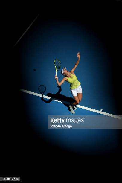 Caroline Wozniacki of Denmark serves in her second round match against Jana Fett of Croatia on day three of the 2018 Australian Open at Melbourne...