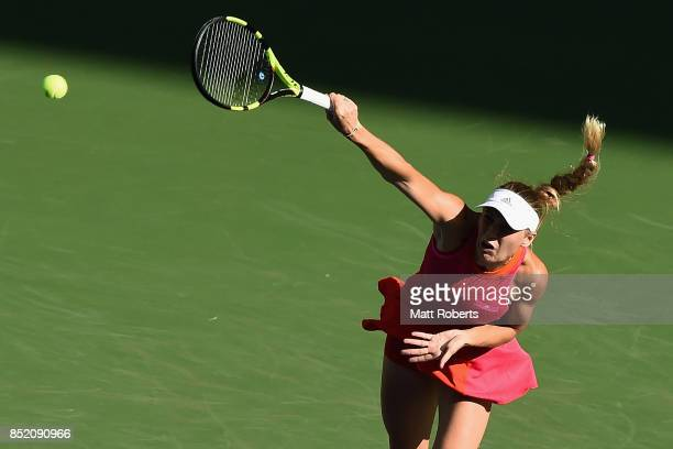 Caroline Wozniacki of Denmark serves in her semi final match against Garbine Muguruza of Spain during day six of the Toray Pan Pacific Open Tennis At...
