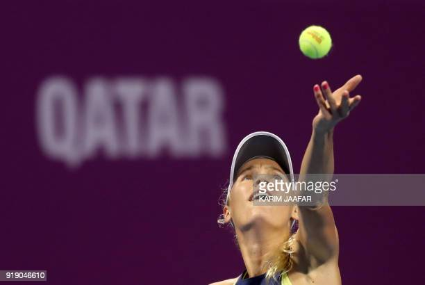 Caroline Wozniacki of Denmark serves the ball to Angelique Kerber of Germany during their singles match in the quarterfinal round of the Qatar Open...