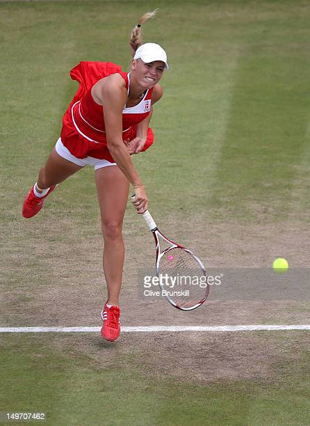 Caroline Wozniacki of Denmark serves the ball to Serena Williams of the United States during the Quarterfinals of Women's Singles Tennis on Day 6 of...