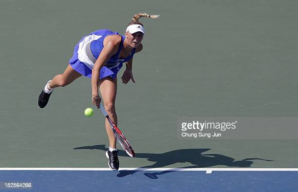 Caroline Wozniacki of Denmark serves to Ekaterina Makarova of Russia during day five of the KDB Korea Open at Olympic Park Tennis Stadium on...