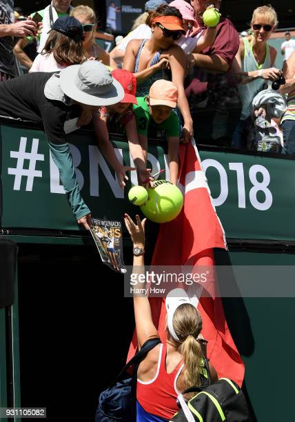 Caroline Wozniacki of Denmark signs autographs after her match against Aliaksandra Sasnovich of Belarus during the BNP Paribas Open at the Indian...