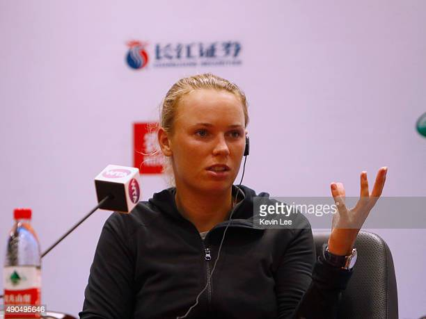 Caroline Wozniacki of Denmark speaks in a press conference after defeated by Anna Karolina Schmiedlova of Slovakia in her match in day 3 of 2015...