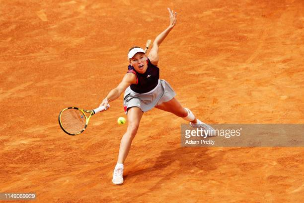 Caroline Wozniacki of Denmark stretches for a forehand during her first round match against Danielle Collins of the USA during day three of the...