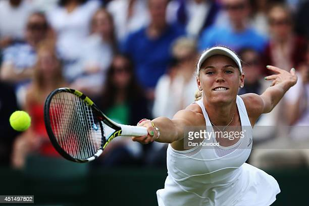 Caroline Wozniacki of Denmark stretches for a return during her Ladies' Singles fourth round match against Barbora Zahlavova Strycova of Czech...