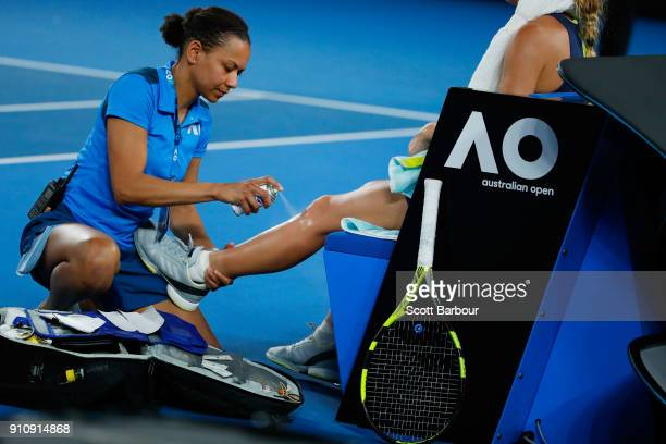 Caroline Wozniacki of Denmark takes a medical timeout in her women's singles final against Simona Halep of Romania on day 13 of the 2018 Australian...