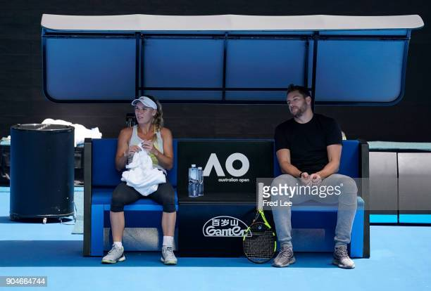 Caroline Wozniacki of Denmark talks with fiancee and former NBA player David Lee during a practice session ahead of the 2018 Australian Open at...