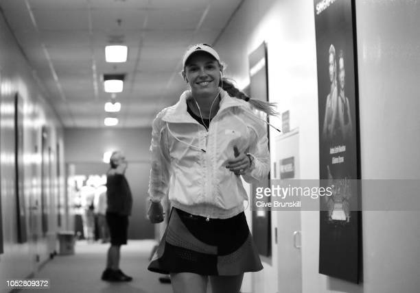 Caroline Wozniacki of Denmark warms up back stage with her coach Piortr Wozniacki during a prior to her singles match with Petra Kvitova of the Czech...
