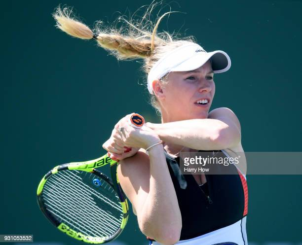 Caroline Wozniacki of Denmark watches her backhand in her match against Aliaksandra Sasnovich of Belarus during the BNP Paribas Open at the Indian...