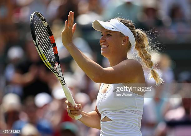 Caroline Wozniacki of Denmark waves to the crowd after winning her Ladies' Singles Third Round match against Camila Giorgi of Italy during day six of...
