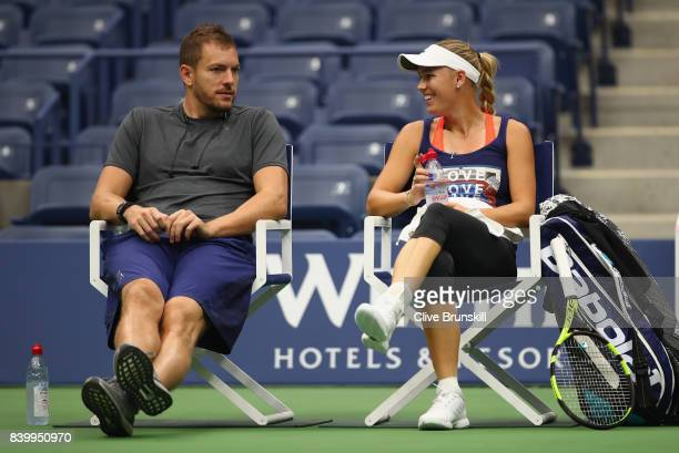 Caroline Wozniacki of Denmark with her boyfriend American profesional basketball player David Lee during a practice session prior to the US Open...