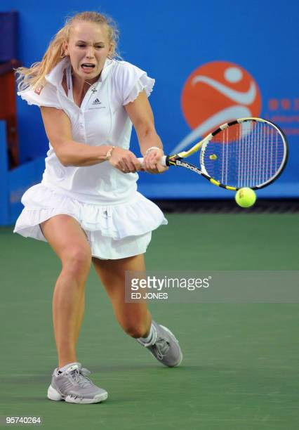 Caroline Wozniacki of Poland returns against Maria Sharapova of Russia during the women's singles final at the Hong Kong Tennis Classic tournament on...