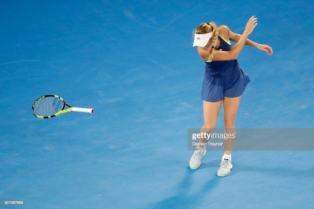 Caroline Wozniacki of Switzerland throws her racquet during her third round match against Kiki Bertens of the Netherlands on day five of the 2018 Australian Open at Melbourne Park on January 19, 2018 in Melbourne, Australia.