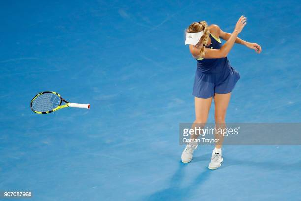 Caroline Wozniacki of Switzerland throws her racquet during her third round match against Kiki Bertens of the Netherlands on day five of the 2018...