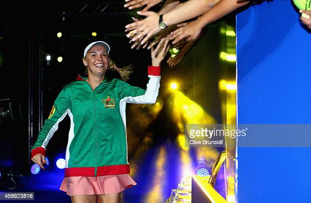 Caroline Wozniacki of the UAE Royals high fives the fans as she runs out for her teams match against the Singapore Slammers during the Coca-Cola...