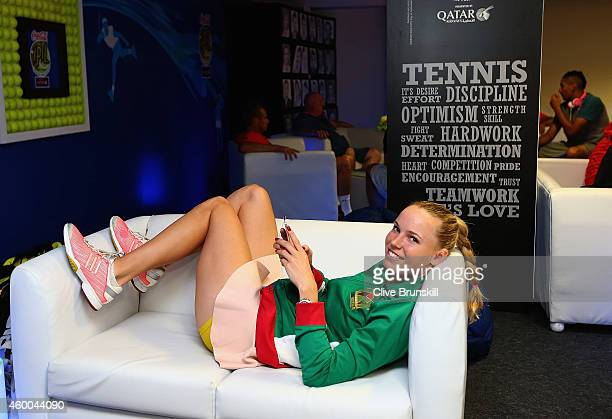 Caroline Wozniacki of the UAE Royals relaxes in the player lounge before her match against Daniela Hantuchova of the Singapore Slammers during the...