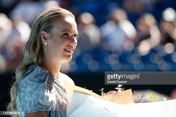 Caroline Wozniacki poses during the women's day ceremony on Rod Laver Arena on day eleven of the 2020 Australian Open at Melbourne Park on January 30...