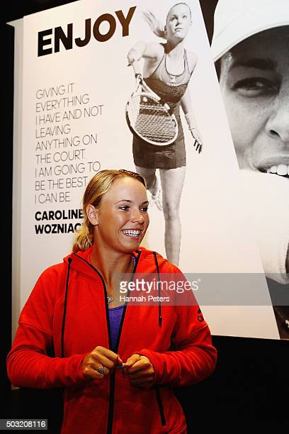 Caroline Wozniacki signs autographs after taking part in an exhibition tennis match on January 3 2016 in Auckland New Zealand The ASB Classic starts...
