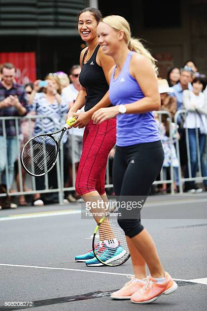 Caroline Wozniacki takes part in an exhibition tennis match with New Zealand netball player Maria Tutaia on January 3 2016 in Auckland New Zealand...