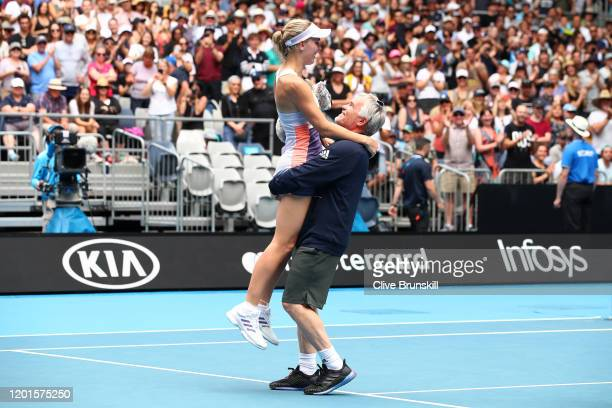 Caroline Wozniacki's coach and father Piotr Wozniacki lifts her up after her Women's Singles third round match against Ons Jabeur of Tunisia day five...