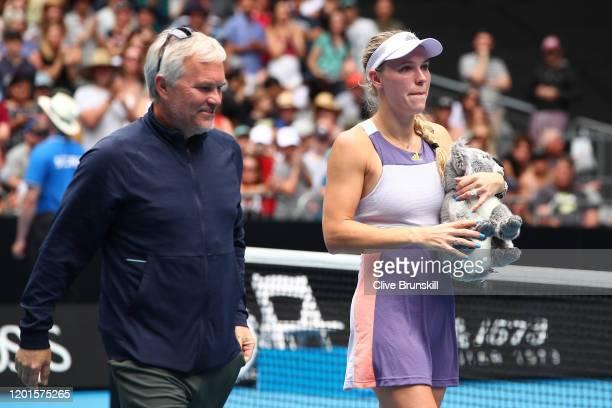 Caroline Wozniacki's coach and father Piotr Wozniacki walks alongside her after her Women's Singles third round match against Ons Jabeur of Tunisia...