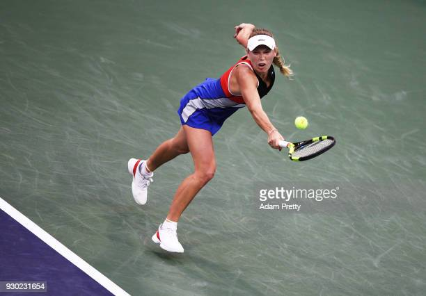 Caroline Wozniaki of Denmark hits a backhand during her match against Lara Arrubarrena during the BNP Paribas Open at the Indian Wells Tennis Garden...