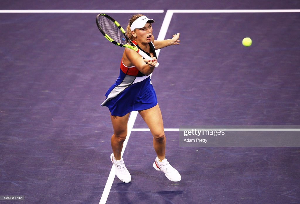 Caroline Wozniaki of Denmark hits a forehand during her match against Lara Arrubarrena during the BNP Paribas Open at the Indian Wells Tennis Garden on March 10, 2018 in Indian Wells, California.