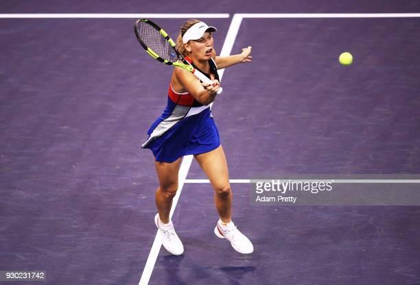 Caroline Wozniaki of Denmark hits a forehand during her match against Lara Arrubarrena during the BNP Paribas Open at the Indian Wells Tennis Garden...
