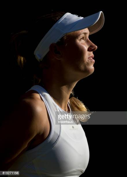 Caroline Wozniaki of Denmark looks in to the sun against Timea Babos of Hungary on day two of the Wimbledon Lawn Tennis Championships at the All...